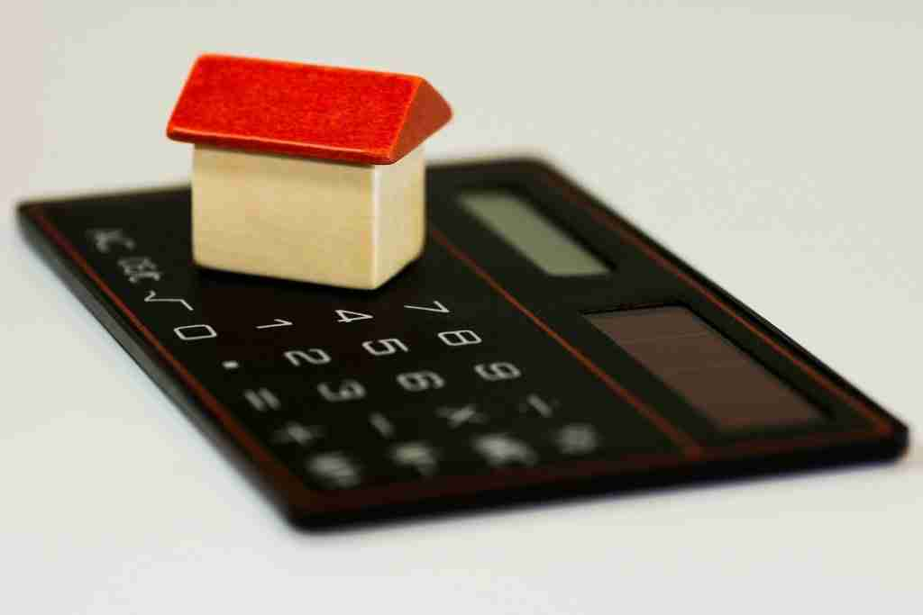 image of calculator to represent the cost of buying a house in 2021